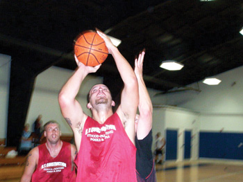 jumper during Community Center adult basketball.