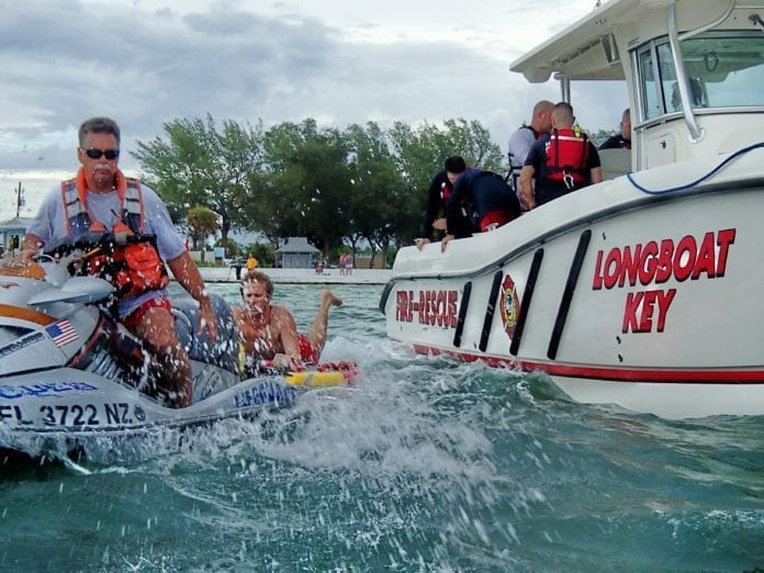 Lifeguard Rex Beach practices rescue techniques at Coquina Beach.