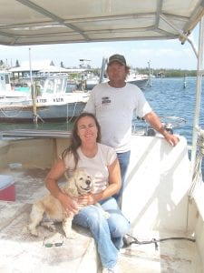 First mate Pup Pup, Capts. Kathe and Mike Fannon