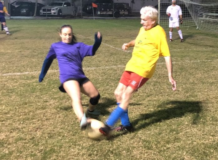 Center of Anna Maria Island adult soccer kick