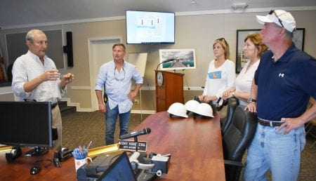 County commissioners tour pier construction site