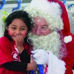 Kids see Santa at Sandbar