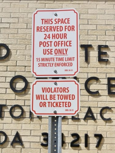 Post office towing includes handicapped parking